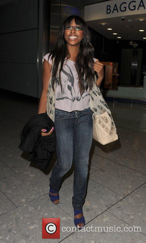 Alexandra Burke arriving at Heathrow Airport, having performed...