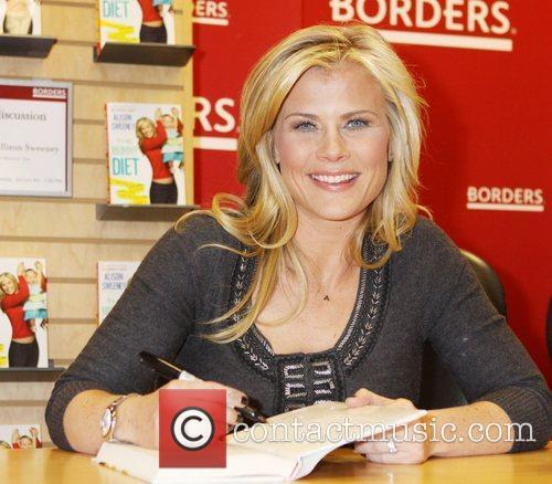 Signs her new book 'The Mommy Diet' at...
