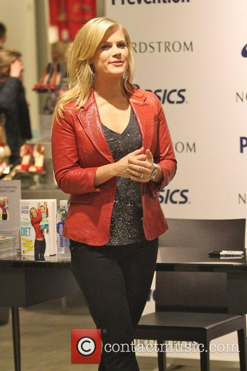 Attends her book signing for 'The Mommy Diet'...