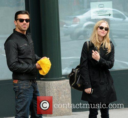 Dominic Cooper and Amanda Seyfried stroll through Soho...