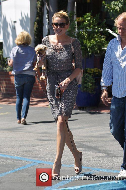Amber Heard departs Fred Segal with her dog...