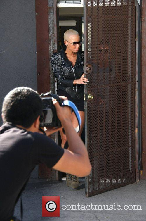 Amber Rose leaving out the back door of...