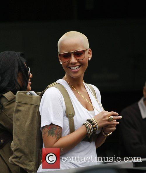 Amber Rose looking at customised cars at Platinum...