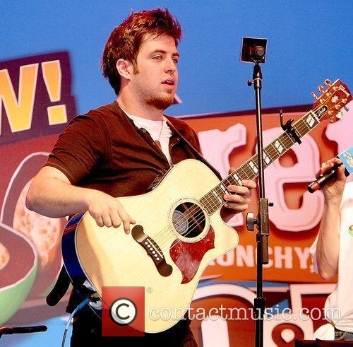 Lee DeWyze from American Idol performs a short...