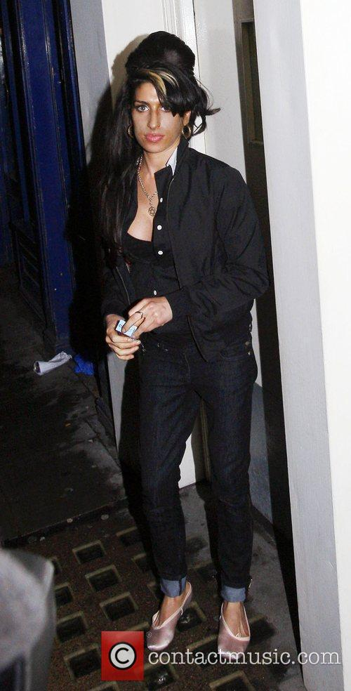 Amy Winehouse leaving a bar in Great Compton...