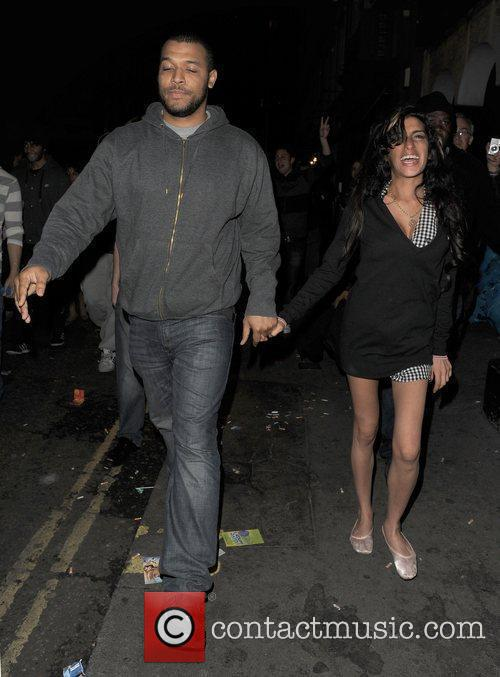 Amy Winehouse walks through Soho at 3.30am, with...