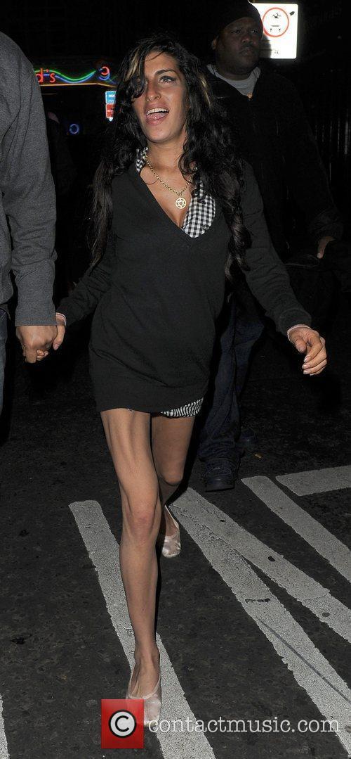 Amy Winehouse walks through Soho at 3.30am, with...