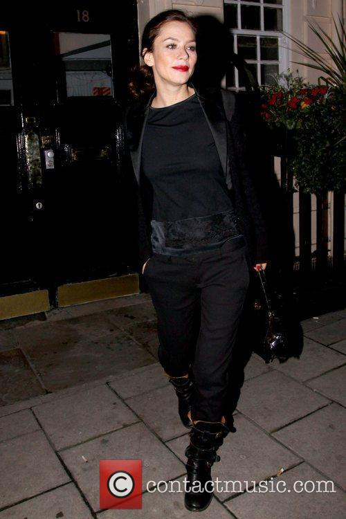 Leaving the Royal Haymarket Theatre after her evening...