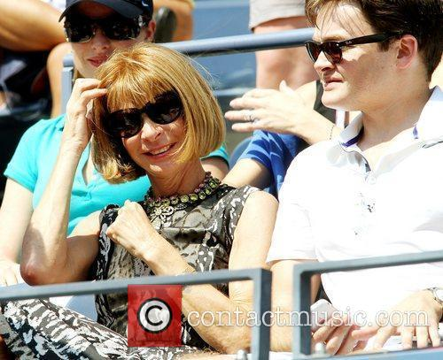 Is seen watching Roger Federer ( SUI) compete...