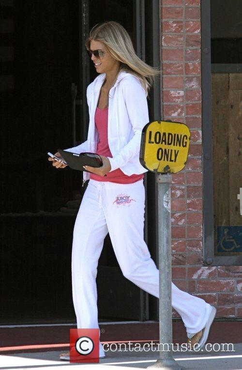AnnaLynne McCord wearing a white Juicy Couture velour...
