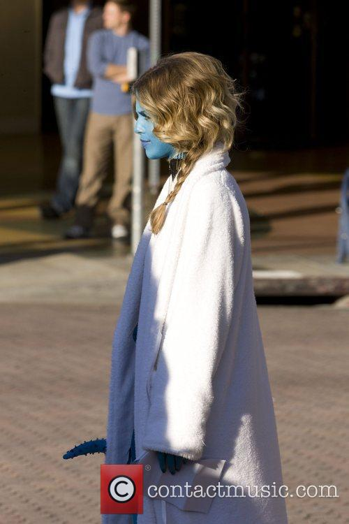 Is seen in an 'Avatar' like costume while...