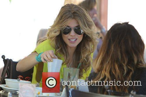 Has lunch with her sister and friends at...