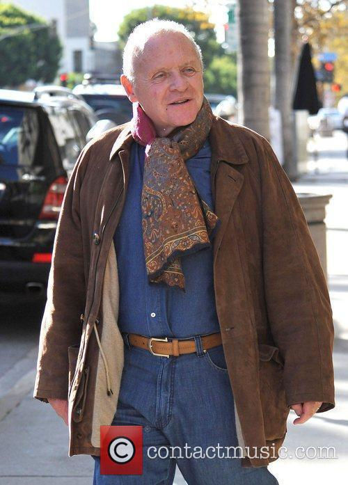 Sir Anthony Hopkins wrapped up in a brown...