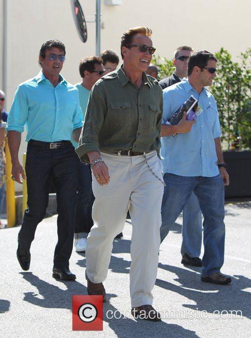 Sylvester Stallone and Arnold Schwarzenegger seen leaving Cafe...
