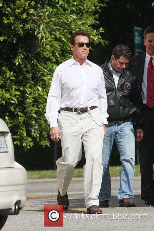 Arnold Schwarzenegger returns to his vehicle after a...