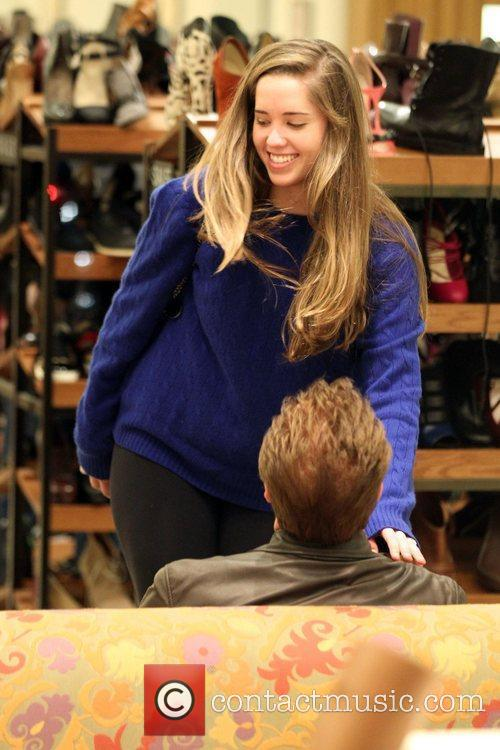 Shopping for shoes with his daughter, Christina Maria...