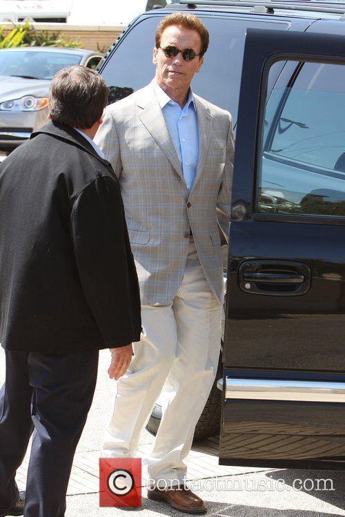Arnold Schwarzenegger leaving Barneys New York in Beverly...
