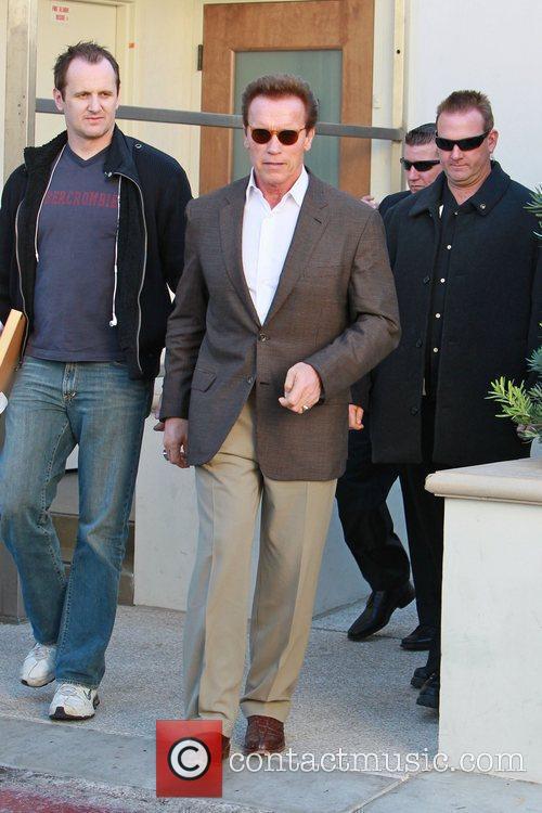 Arnold Schwarzenegger leaving Caffe Roma in Beverly Hills...
