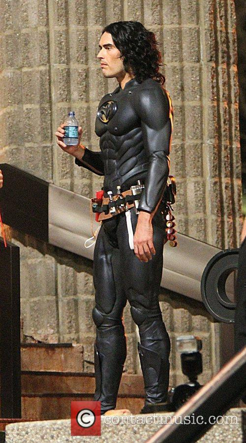 Russell Brand dresses as Batman on the set...
