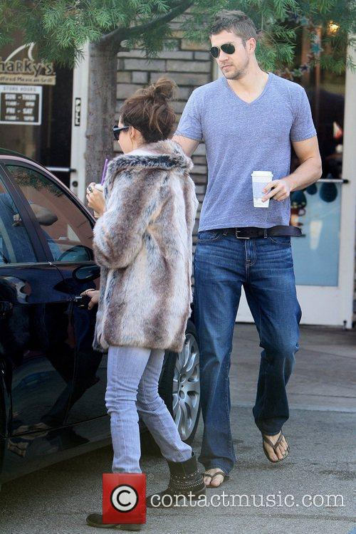 Ashley Tisdale and her boyfriend are seen grabbing...