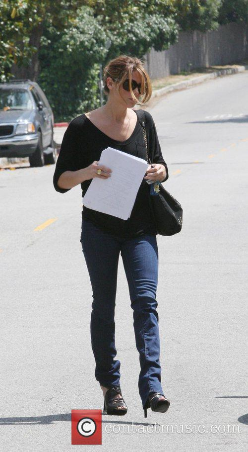 Ashley Greene arriving at a residence with papers...