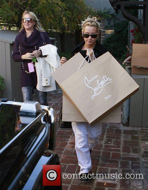 Shops at Christian Louboutin with her mother Lisa...