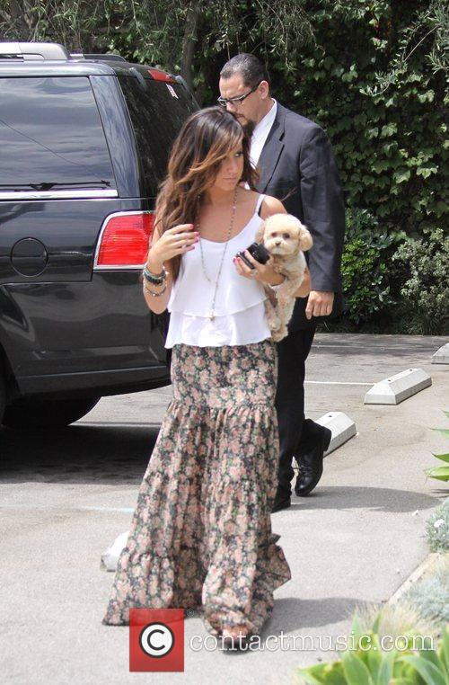 Ashley Tisdale and a friend are seen heading...