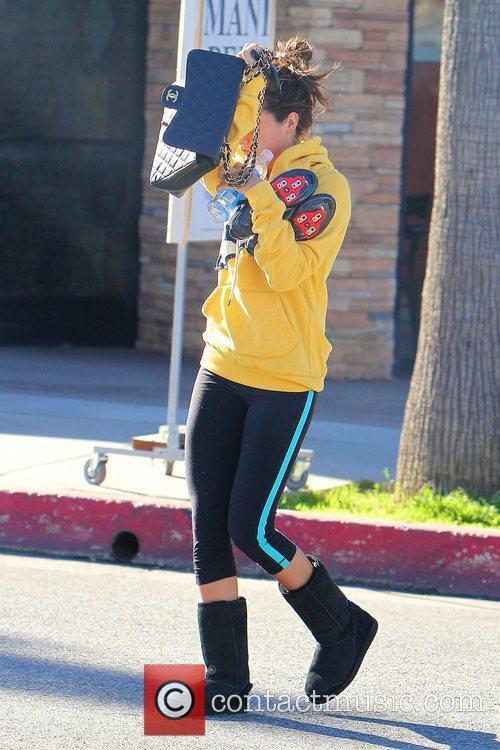 Ashley Tisdale appears a little shy whilst out...