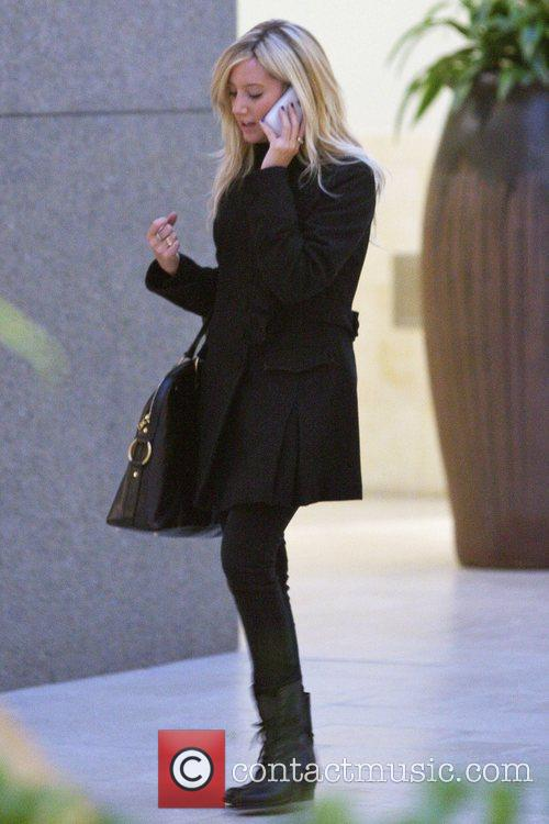 Ashley Tisdale talking on her phone while out...