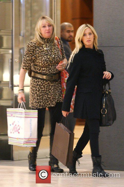 Ashley Tisdale shopping at Louis Vuitton with her...