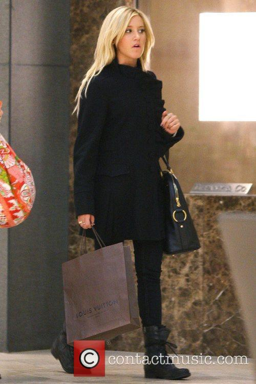Ashley Tisdale carrying a Louis Vuitton shopping bag...