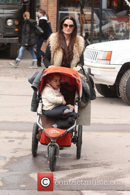 Kyle Richards pushes her daughter in an urban...