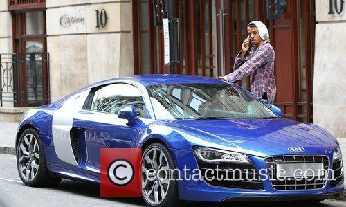 Shows off an Audi R8 sports car as...