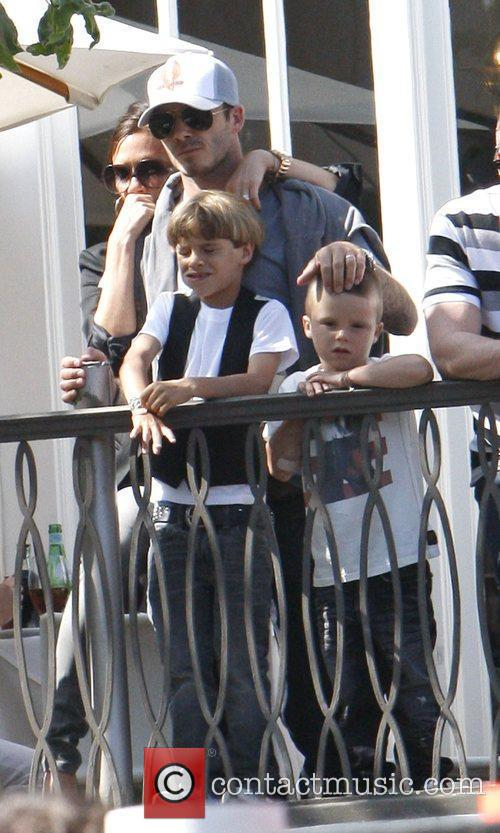 Victoria and David Beckham with their sons Cruz...