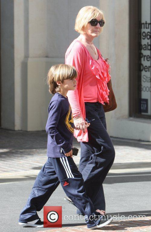 The Beckham children out shopping with family and...