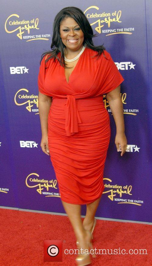 Kim Burrell  appears on the red carpet...