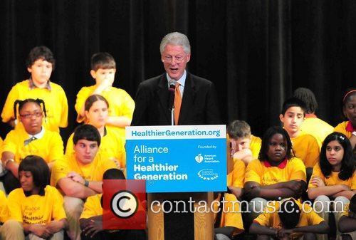 Former U.S. President Bill Clinton makes a South...