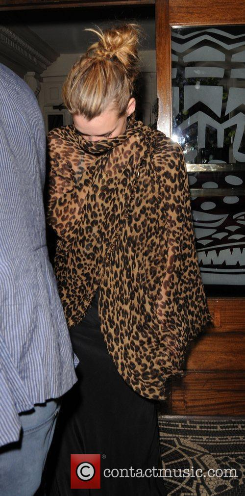 Billie Piper in a leopard patterned coat leaving...