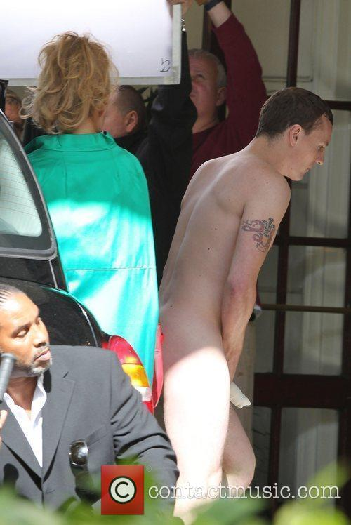 Billie Piper with a naked actor on the...