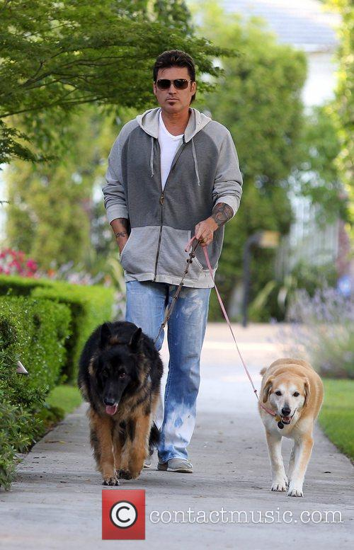 Walks his dogs in Toluca Lake
