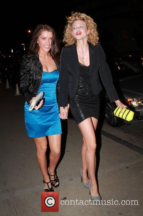 Arrives at Boa Steak House with a friend