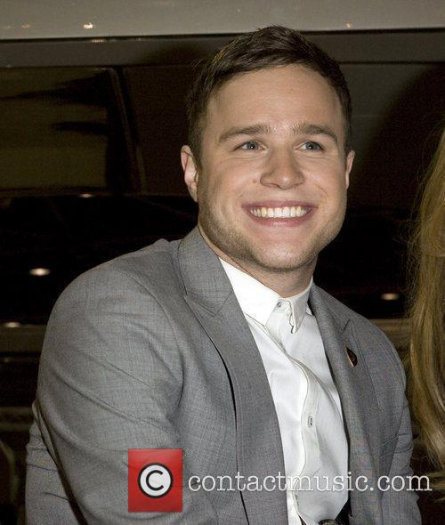 Olly Murs attends a photocall to open the...