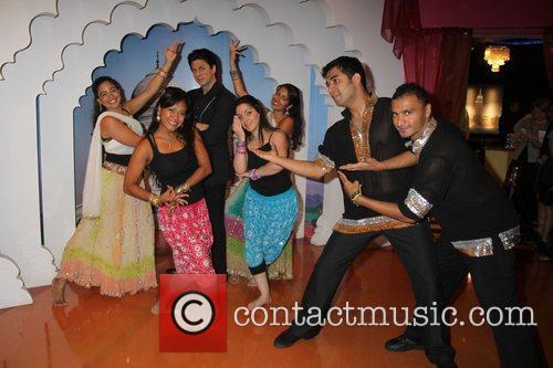 A troupe of Bollywood Axion dancers pose with...