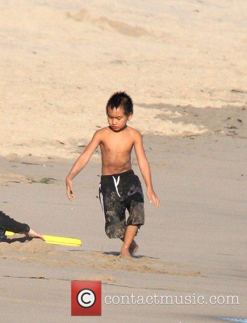 Maddox Jolie-Pitt enjoys a day on Malibu Beach...