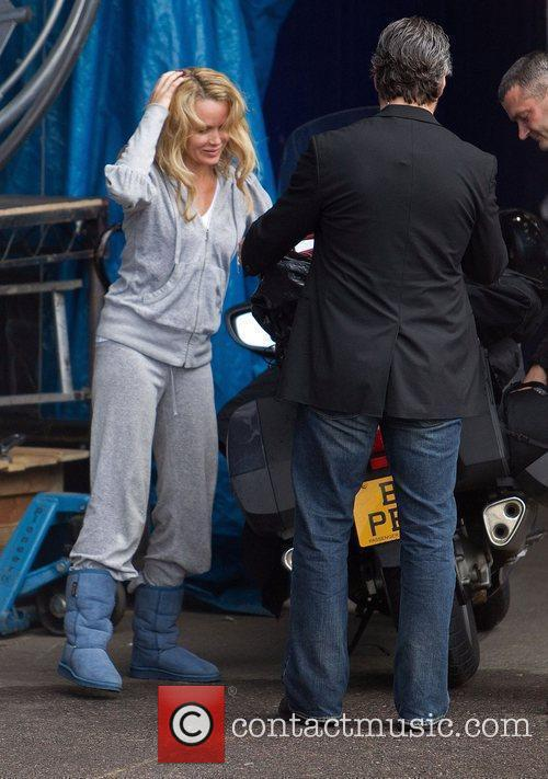 Amanda Holden arrives on a Motorcycle Taxi...