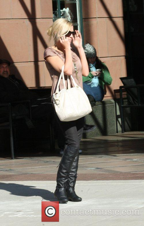 Brittany Snow is seen talking on her mobile...