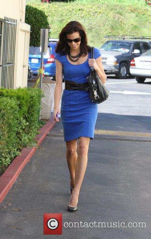 Brooke Burns in a a deep blue dress...
