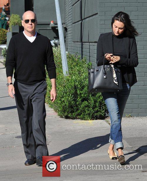 Bruce Willis and Emma Heming are seen heading...
