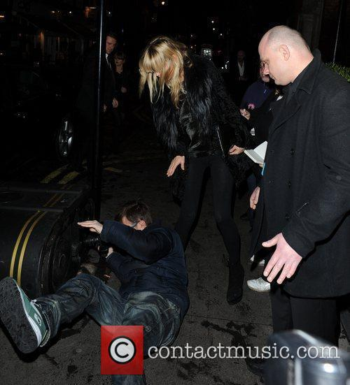 Kate Moss has a paparazzi photographer fall at...