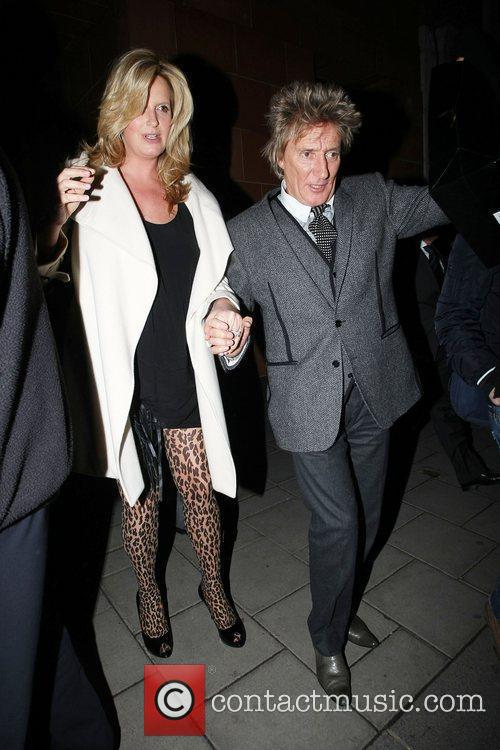 Rod Stewart and heavily pregnant wife Penny Lancaster...
